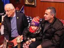 Congreesman Bill Pascrell Jr.with refugee familiy.