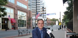 Mayoral candidate, Charlie Kratovil is interviewed by Oscar Alberto Quintana, Americano Publisher, on George Street in New Brunswick, New Jersey.