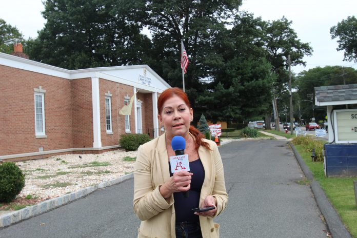 Assemblywoman Ivonne Lopez taping a community event announcement for the Americano Newspaper.