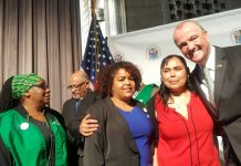 Reynalda Cruz getting a hug from New Jersey Governor, Phil Murphy after signing a paid sick leave bill into law in Trenton, NJ.