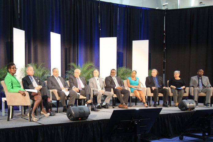 Left, Hester Agudosi, Esq., NJ Diversity Chief on stage with other panel members.