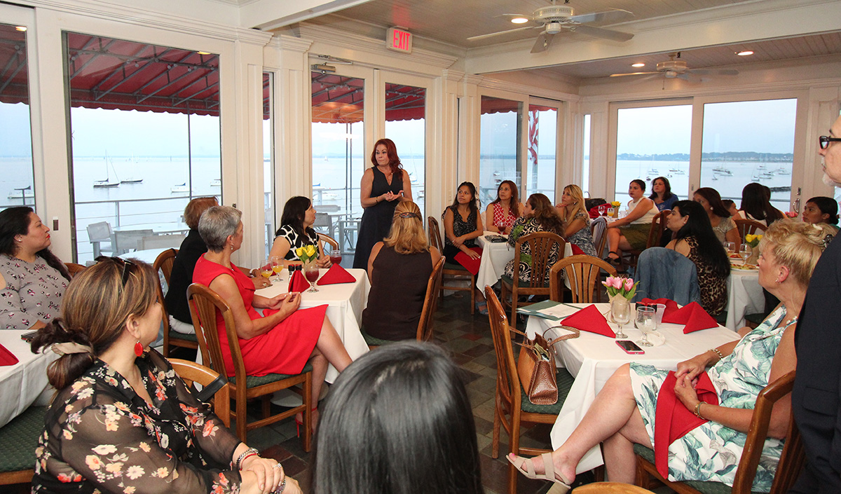 Photo by Dio Cholula  LUPE FUND INC. members listening to Assemblywoman Ivonne Lopez (LD-19) at the Raritan Yacht Club in Perth Amboy, New Jersey.