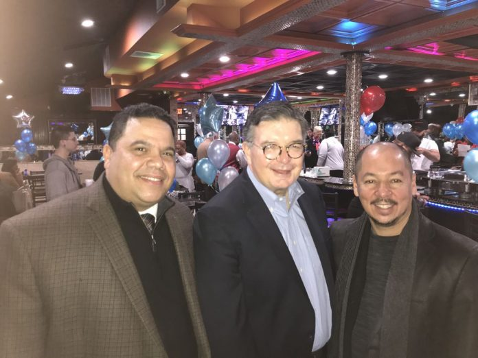 Trenton Councilman candidate, Damian Malave; County Executive, Brian Hughes and Marino Posso of the Latino Merchants Association.